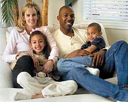 Thurl Bailey with his wife and two sons.