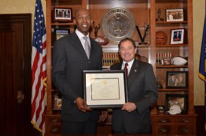 Thurl Bailey receives ambassador to the refugee community appointment from Governor Gary Herbert.