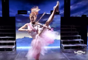 Lindsey Stirling performing in her film, Brave Enough