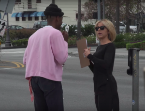 Lindsey Stirling interviewing people while disguised as a blonde