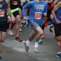 Benjamin Pachev wearing crocs while running a half marathon