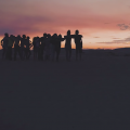 picture of children watching a sunset in a music video to raise awareness about the horrors of sex trafficking and how to help