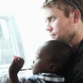 Tim Ballard with his adopted son