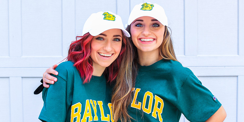 Picture of Brooklyn and Bailey in college shirts